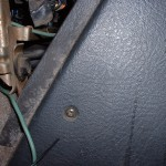 Center console front screw, driver's side