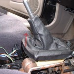 Lift rear of shift boot